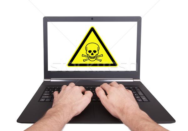 Man working on laptop, toxic Stock photo © michaklootwijk