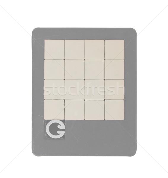 Vieux puzzle slide jeu isolé blanche Photo stock © michaklootwijk