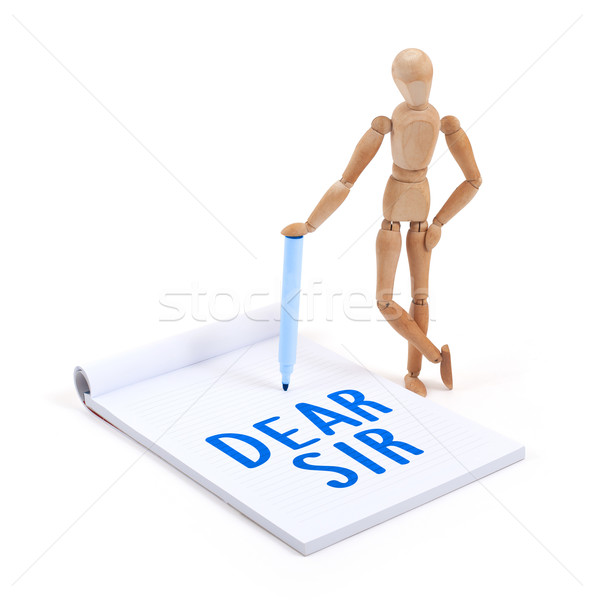 Stock photo: Wooden mannequin writing - Dear sir