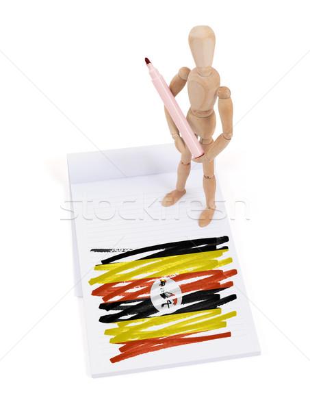 Fából készült próbababa rajz Uganda zászló papír Stock fotó © michaklootwijk