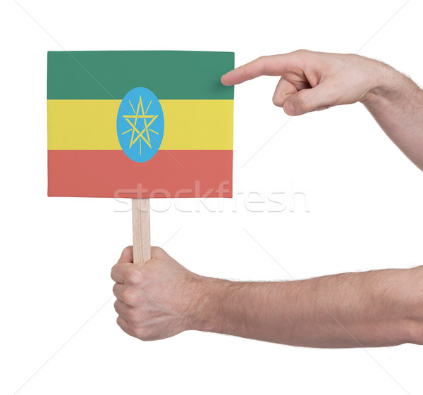 Hand holding small card - Flag of Ethiopia Stock photo © michaklootwijk