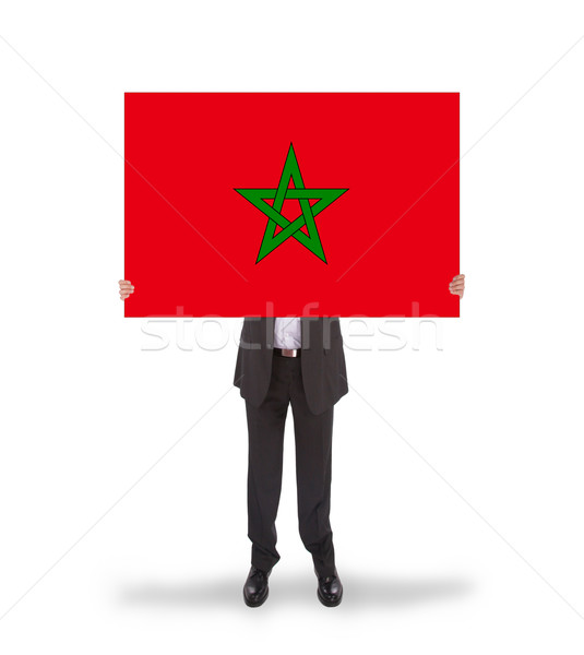 Businessman holding a big card, flag of Morocco Stock photo © michaklootwijk