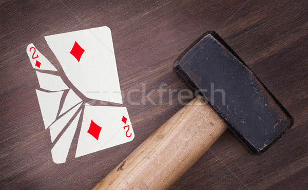 Hammer with a broken card, two of diamonds Stock photo © michaklootwijk