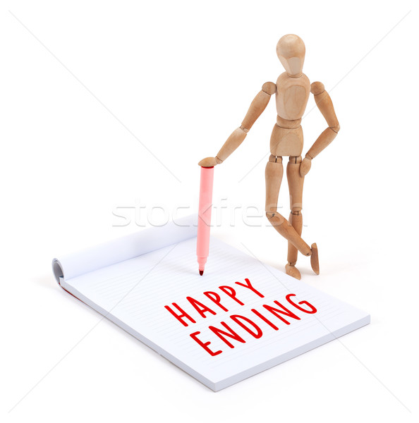 Wooden mannequin writing in scrapbook - Happy ending Stock photo © michaklootwijk