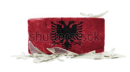 Stockfoto: Baksteen · gebroken · glas · geweld · vlag · Kirgizië · muur