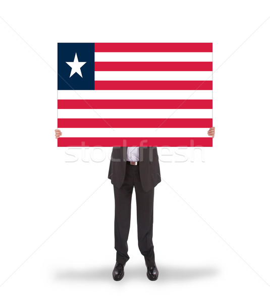 Businessman holding a big card, flag of Liberia Stock photo © michaklootwijk