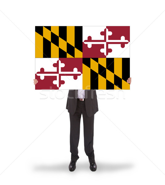 Smiling businessman holding a big card, flag of Maryland Stock photo © michaklootwijk