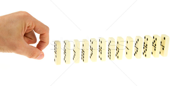Hand ready to push dominoes Stock photo © michaklootwijk