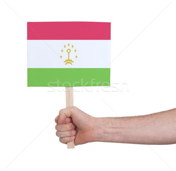 Hand holding small card - Flag of Tajikistan Stock photo © michaklootwijk