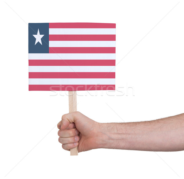 Hand holding small card - Flag of Liberia Stock photo © michaklootwijk