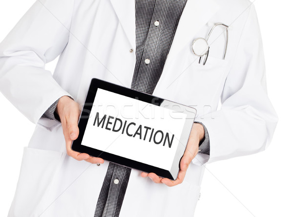 Stock photo: Doctor holding tablet - Medication