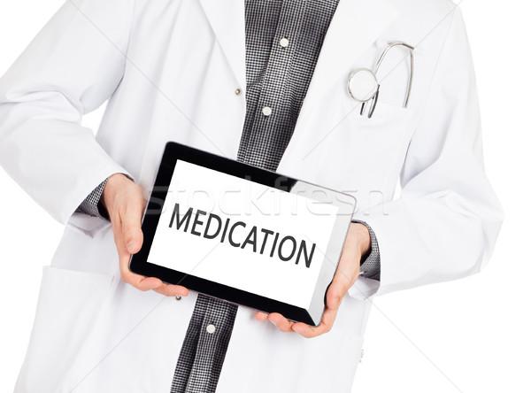 Doctor holding tablet - Medication Stock photo © michaklootwijk