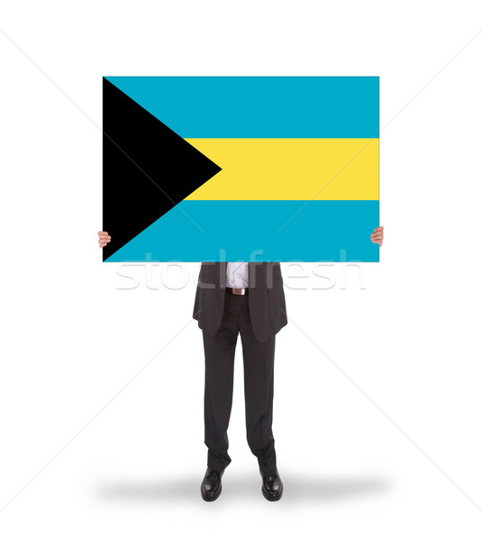 Businessman holding a big card, flag of the Bahamas Stock photo © michaklootwijk