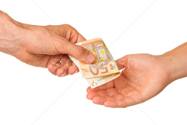 Man giving 50 euro to a woman Stock photo © michaklootwijk