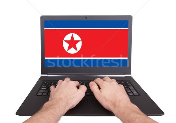 Hands working on laptop, North Korea Stock photo © michaklootwijk