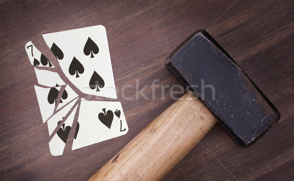 Hammer with a broken card, seven of spades Stock photo © michaklootwijk