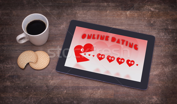 Online dating on a tablet Stock photo © michaklootwijk