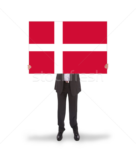 Smiling businessman holding a big card, flag of Denmark Stock photo © michaklootwijk