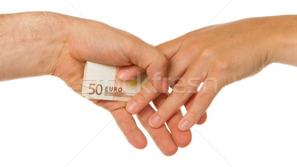 Man secretly giving 50 euro to a woman Stock photo © michaklootwijk