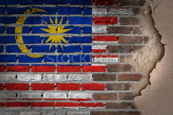 Escuro parede de tijolos gesso Malásia textura bandeira Foto stock © michaklootwijk