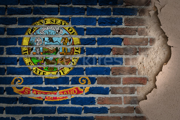 Oscuro pared de ladrillo yeso Idaho textura bandera Foto stock © michaklootwijk