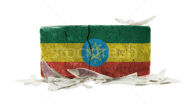кирпичных битое стекло насилия флаг Эфиопия стены Сток-фото © michaklootwijk