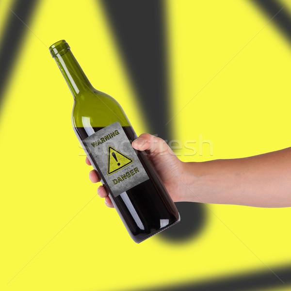 Mano botella alerta peligro vino Foto stock © michaklootwijk