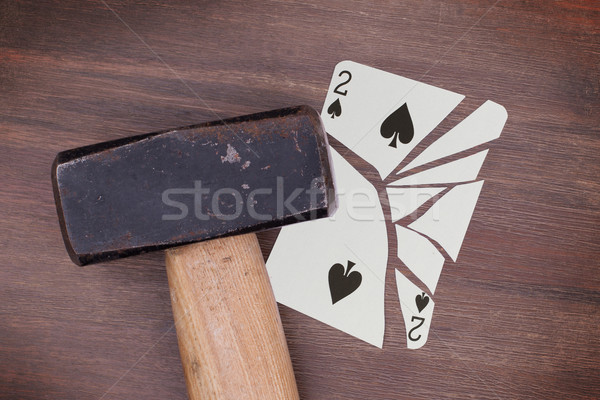 Hammer with a broken card, two of spades Stock photo © michaklootwijk