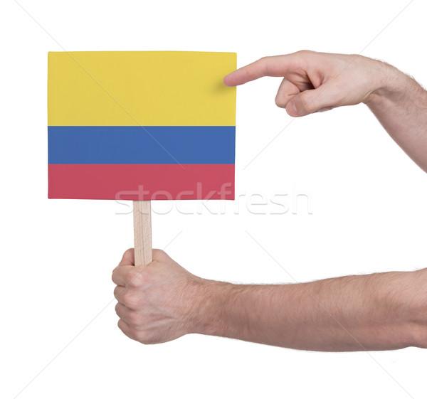 Kéz tart kicsi kártya zászló Colombia Stock fotó © michaklootwijk