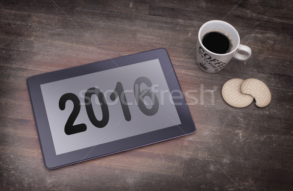 Tablet touch computer gadget on wooden table - 2016 Stock photo © michaklootwijk