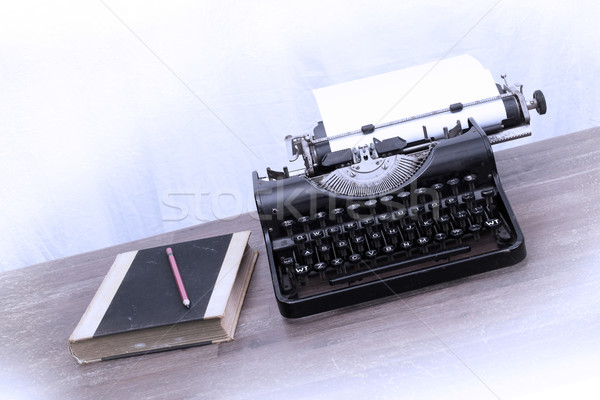 Vintage typewriter and old books Stock photo © michaklootwijk