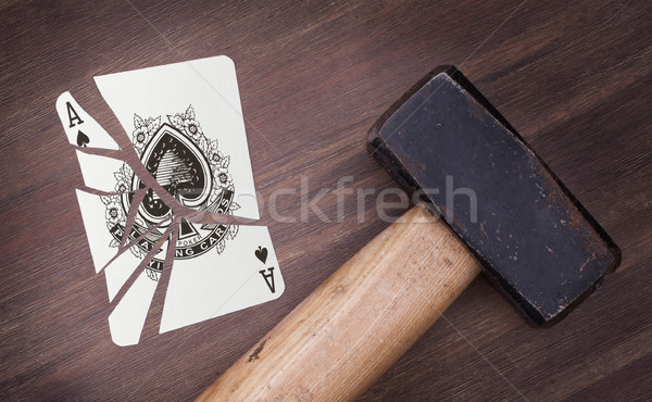 Hammer with a broken card, ace of spades Stock photo © michaklootwijk