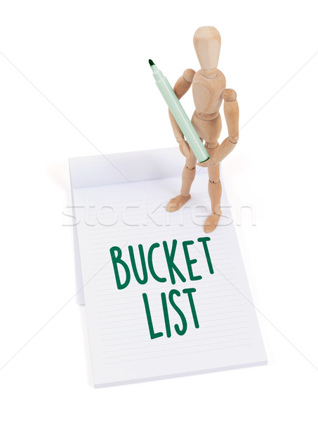 Stock photo: Wooden mannequin writing - Bucket list