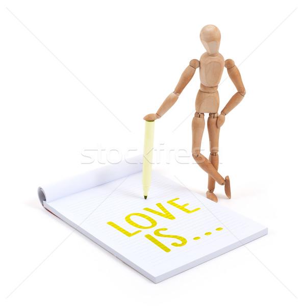 Houten etalagepop schrijven liefde plakboek papier Stockfoto © michaklootwijk
