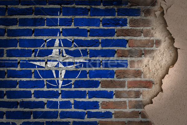 Dark brick wall with plaster - NATO Stock photo © michaklootwijk