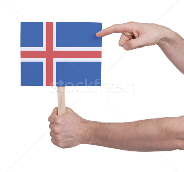Hand holding small card - Flag of Iceland Stock photo © michaklootwijk