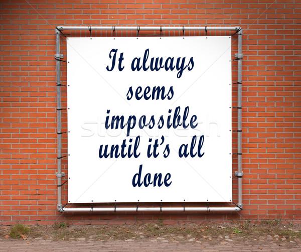 Büyük afiş ilham verici aktarmak tuğla duvar Stok fotoğraf © michaklootwijk