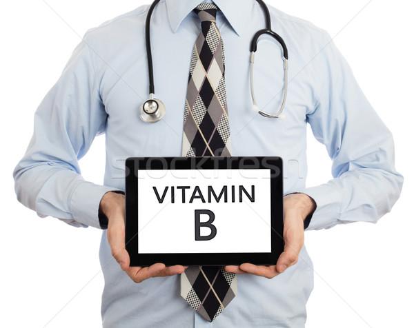 Doctor holding tablet - Vitamin B Stock photo © michaklootwijk