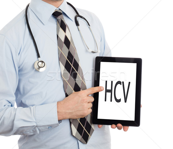 Doctor holding tablet - HCV Stock photo © michaklootwijk