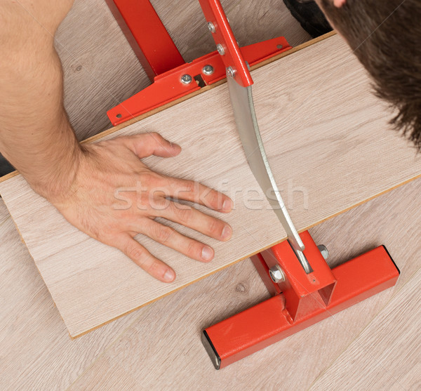 Stock photo: Red tool for cutting laminate