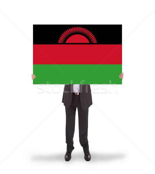 Businessman holding a big card, flag of Malawi Stock photo © michaklootwijk