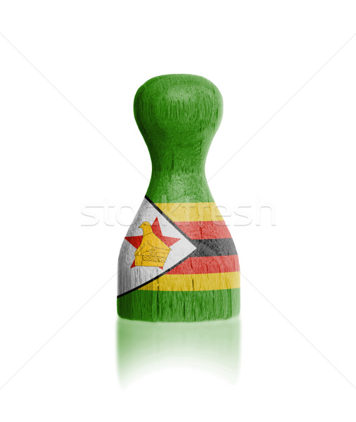 Wooden pawn with a flag painting Stock photo © michaklootwijk