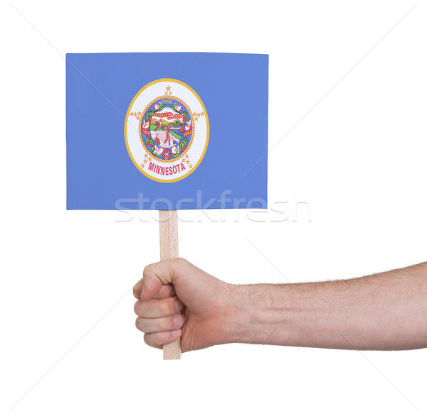 Hand holding small card - Flag of Minnesota Stock photo © michaklootwijk
