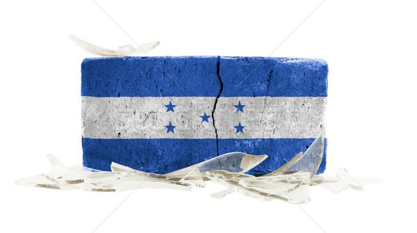 Baksteen gebroken glas geweld vlag Honduras muur Stockfoto © michaklootwijk