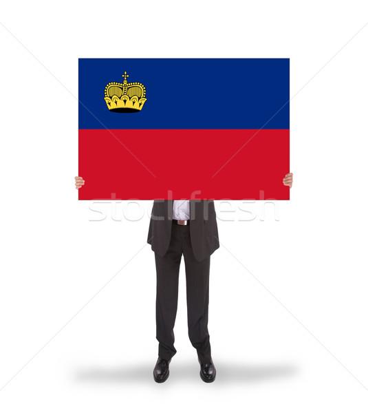 Businessman holding a big card, flag of Liechtenstein Stock photo © michaklootwijk