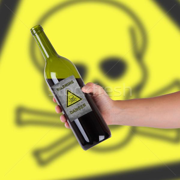 Mano botella alerta tóxico vino Foto stock © michaklootwijk