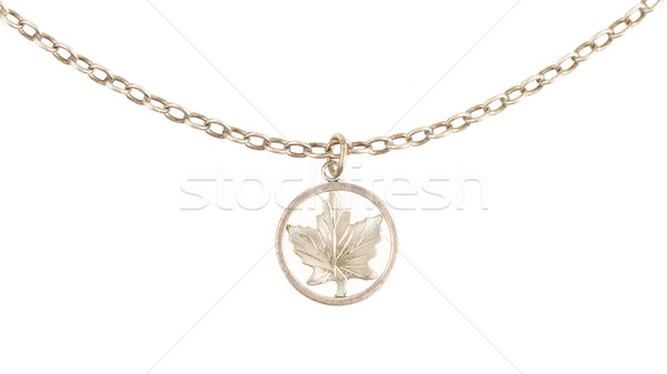 Old filthy silver hanger on a silver chain (maple leaf) Stock photo © michaklootwijk