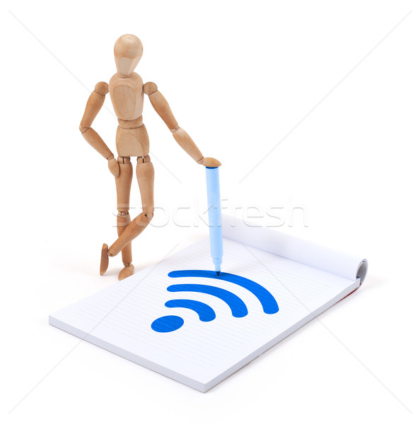 Wooden mannequin writing - WiFi Stock photo © michaklootwijk