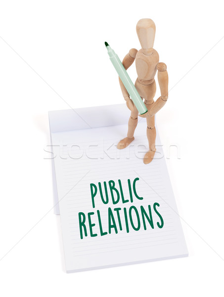 Wooden mannequin writing - Public relations Stock photo © michaklootwijk
