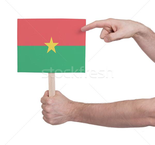 Hand holding small card - Flag of Burkina Faso Stock photo © michaklootwijk